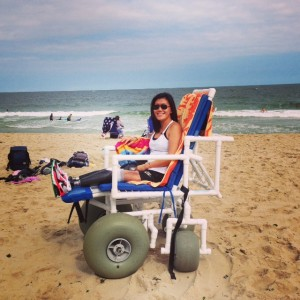 "Me in my ""monster truck"" of a beach wheelchair. Thanks Wade!"